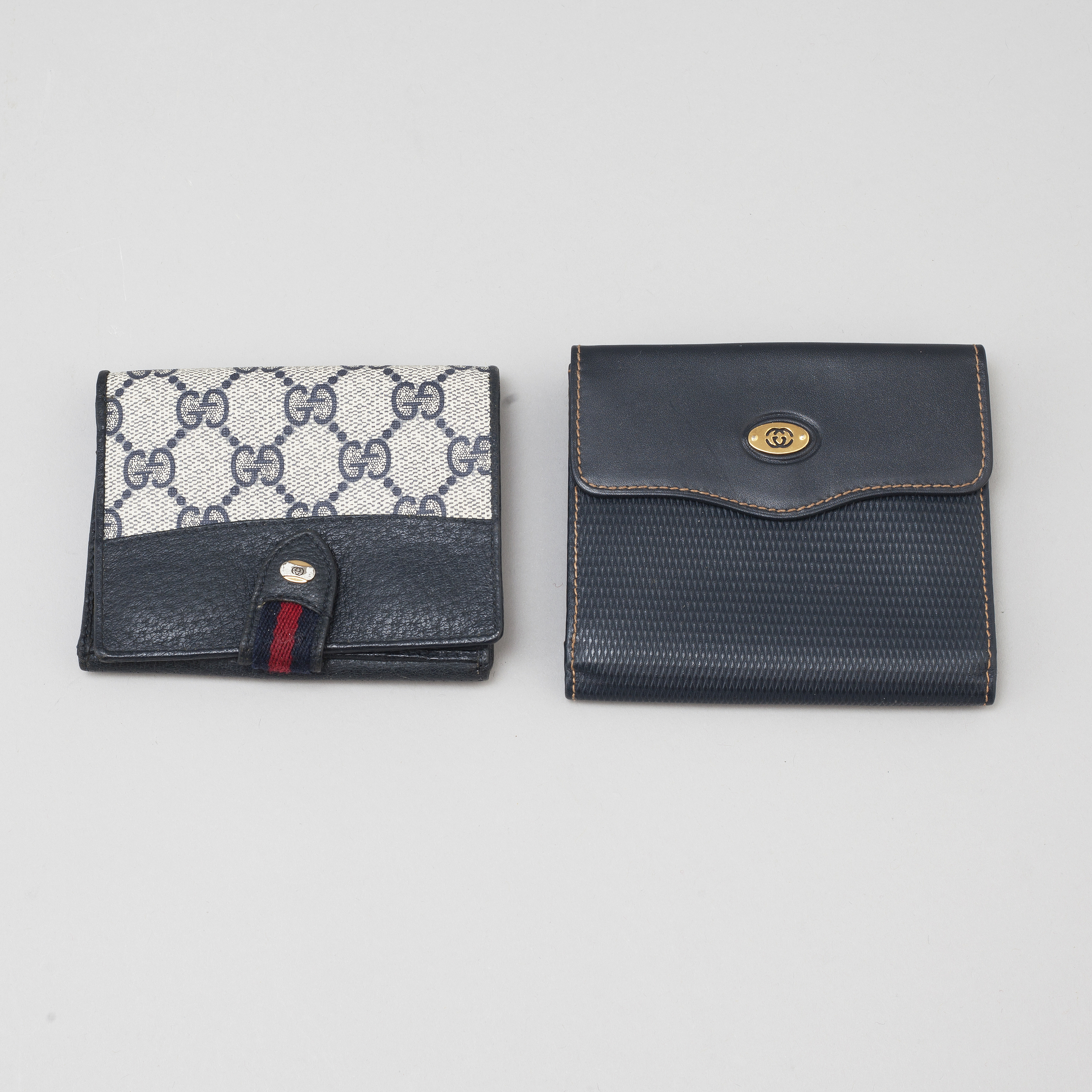 59daf79d95cc GUCCI, two leather wallets. - Bukowskis