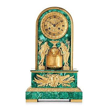 136. An Empire early 19th century mantel clock.