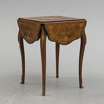 A Louis XV-style table, mid 20th century.