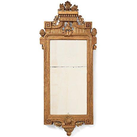 A gustavian mirror by nils sundström dated 1774 .