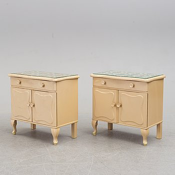 A pair of bedside tables, mid 20th century.