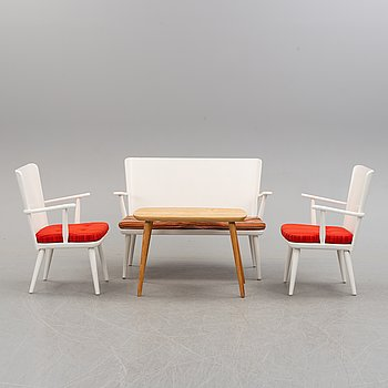 A second half of the 20th century sofa, pair of armchairs and coffee table by Göran Malmvall.