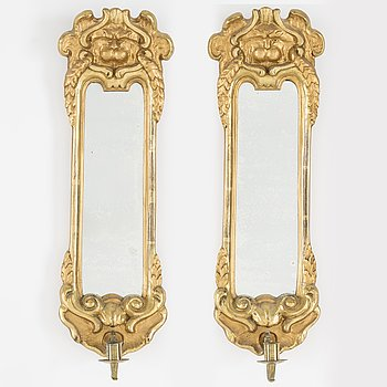 A pair of late baroque-style wall mirror sconces. First half of the 20th century.