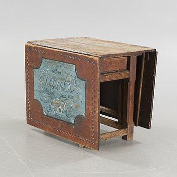 A mid 19th century gateleg table.