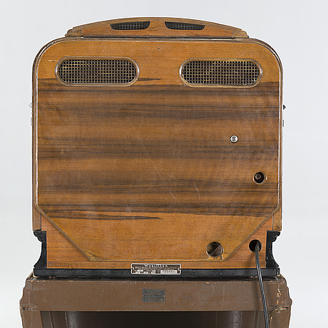 """Jukebox, wurlitzer model 81, on original wooden stand """"mae west""""."""