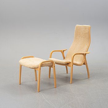 A 'Lamino' easy chair with stool by Yngve Ekström, Swedese.