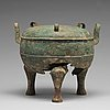 """A bronze tripod food vessel and cover, """"ding"""", eastern zhou dynasty."""