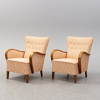 A pair of 1930's stained beech easy chairs.