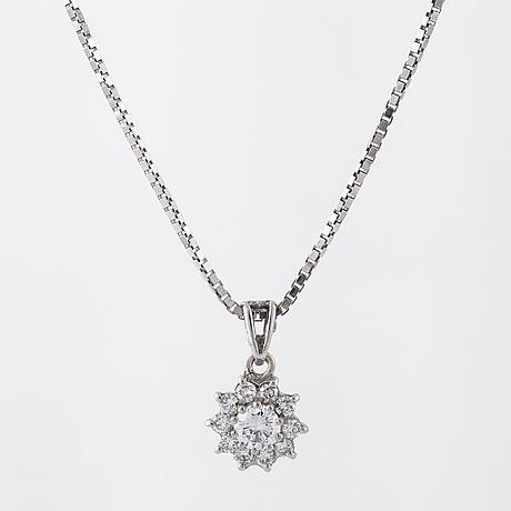 A brilliant cut diamond pendant