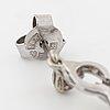 A pair of brilliant cut diamod earrings.