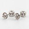 A pair of brilliant cut diamond earrings