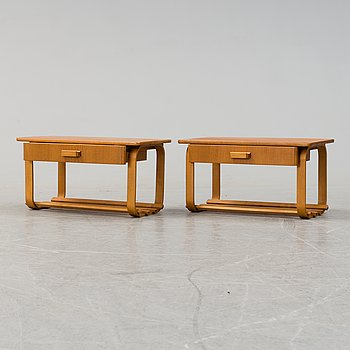 A pair of teak veneered bedside tables, second half of the 20th century.