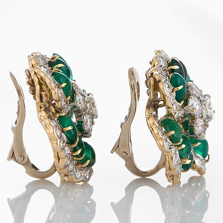 A pair of bulgari earrings set with cabochon-cut emeralds and round brilliant-cut diamonds.