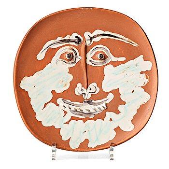 "116. Pablo Picasso, a ""Visage barbu"" faience dish, Madoura, Vallauris, France, post 1959. A. Ramié 413."