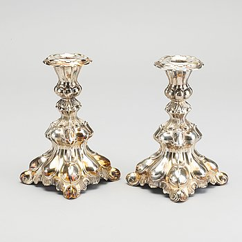 A PAIR SILVER CANDLE STICKS.