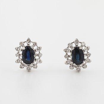 A pair of sapphire and single cut diamond earrings.