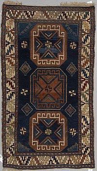 A RUG, a semi-antique Caucasian, ca 175 x 102 cm.