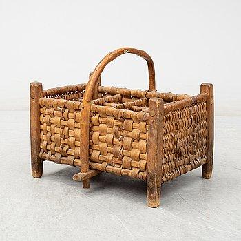 A 19th century wine bottle basket.