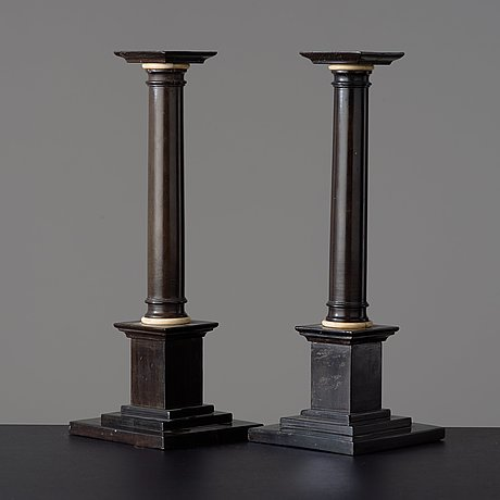 A pair of empire early 19th century candlesticks.