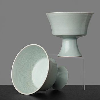31. A pair of celadon glazed stemcups, China, 20th Century with Yongzheng mark.