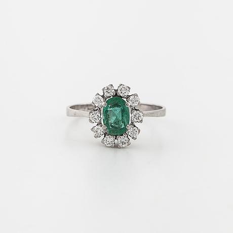 A emerald and brilliant cut diamond ring