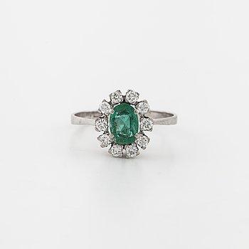 A emerald and brilliant cut diamond ring.