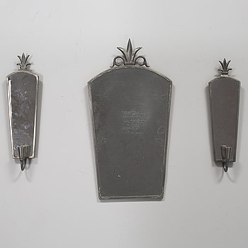 A pewter mirror and a pair of wall sconces from the first half of the 20th century.