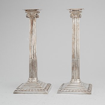 A pair of English 18th century silver candlesticks, worn marks, London.
