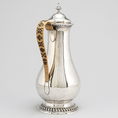 An english 18th century silver wine jug, mark of augustin le sage, london 1770