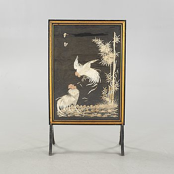 A fire screen from the first half of the 20th century.