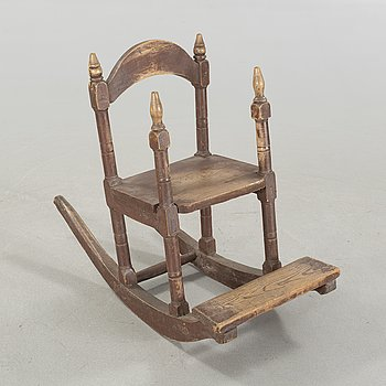 A childs rocking chair, 19th century.