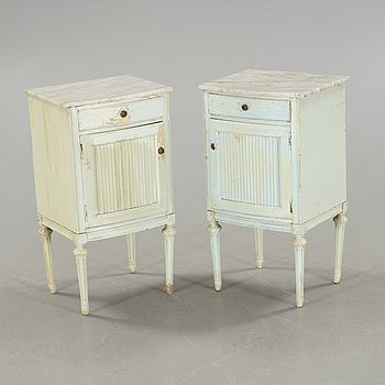 A pair of gustavian style bedside tables, around the year 1900.