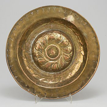 A possibly 17th century gilded copper christening plate.