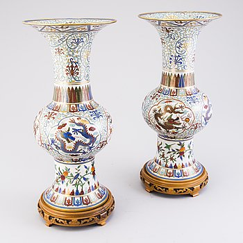 A pair of 20th Century cloisonné urns.