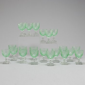 A set of 23 white wine glasses, mid 20th century.