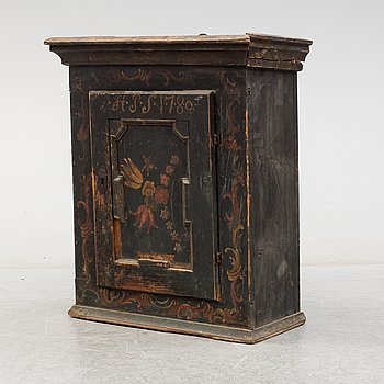 A Norwegian hanging cupboard dated 1780.