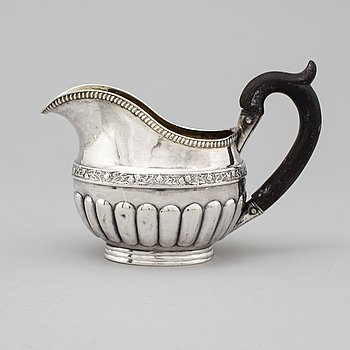 A Russian 19th century parcel-gilt silver cream jug, mark of Jonas Auvin possibly, St. Petersburg 1837.
