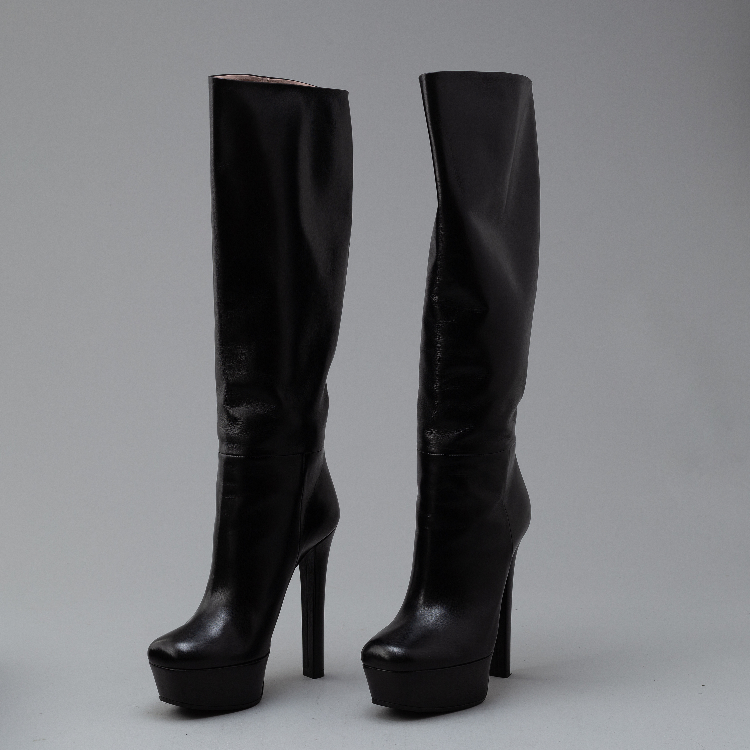 1184934ba75 GUCCI, a pair of platform, high heel leather boots, size 37½ ...