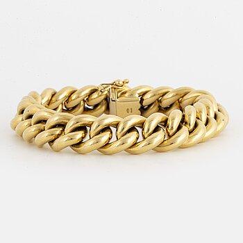 18K gold curb link bracelet.