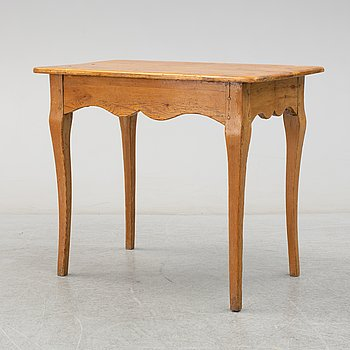 A 18th/19th century rokoko table.