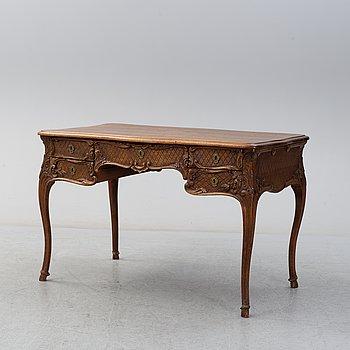 A circa 1900 Rococo style writing desk.