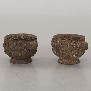 A pair of Swedish cast iron Baroque garden urns.