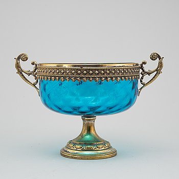 A 20th century glass and metal bowl.
