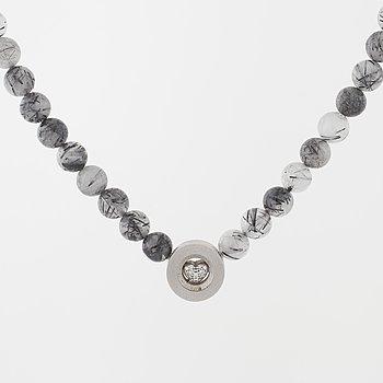 OLE LYNGGAARD, a rutile quartz necklace and a brilliant cut diamond clasp.
