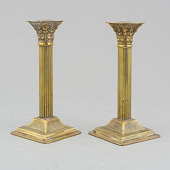 A pair of circa 1900 silver plated candle sticks.