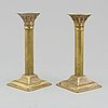 A pair of circa 1900 silver plated candle sticks