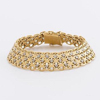 ARMBAND 18K guld och vitguld, x-länk, 63,4 g GK Smycken.