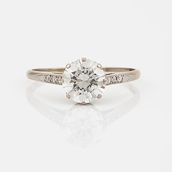 A round brilliant-cut diamond ring.