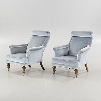 A pair of armchairs from the turn of the 20th century.