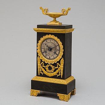 An early 19th century Epire mantel clock.